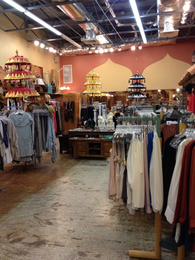 A look inside the store from front to back, looking at clothes and the space.