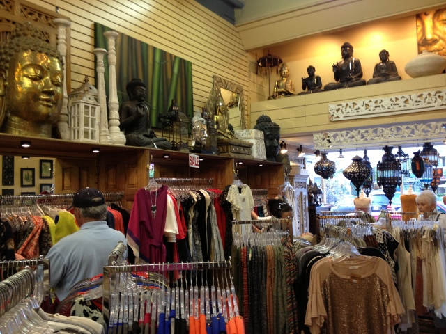 More clothing, accessories and home decor toward the front entrance.